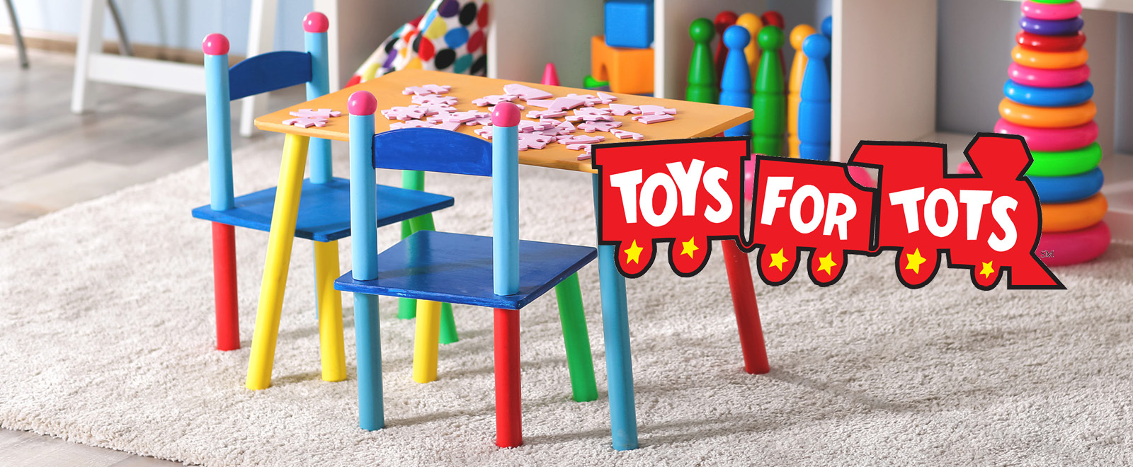 Toys for Tots train logo in playroom with toys