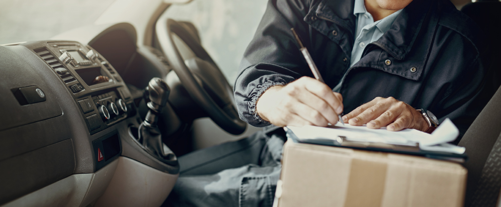 A man doing paperwork in a commercial vehicle